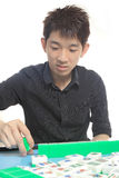 Chinese man play Mahjong Royalty Free Stock Photos