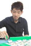 Chinese man play Mahjong Royalty Free Stock Photos