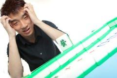 Chinese man play Mahjong, Stock Image