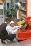 A Chinese man playing with his granddaughter, Royalty Free Stock Photo