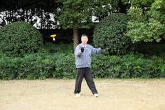Chinese man playing Yo Yo game. In a park. Shanghai, China Royalty Free Stock Photo