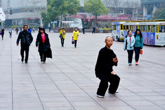 Chinese man practice Tai Chi in Nanjing Road Shanghai China Royalty Free Stock Photo