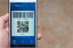 Chinese man preparing a payment via QR code Stock Images