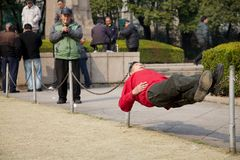 Chinese man tai chi resting in public park  Stock Photography