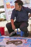 Chinese Man Selling Snake Venom Stock Photo