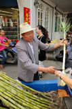 Chinese Man Selling Sugar Cane Stock Photography