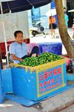 Chinese man sells betel nuts Stock Photos