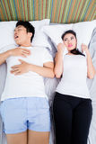 Chinese man snoring keeping his wife awake Stock Images