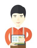 Chinese man standing with his tablet Royalty Free Stock Photography