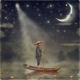 Chinese man  stands in boat Royalty Free Stock Photo