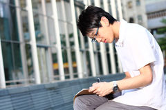 Chinese man studing outdoor Stock Photos