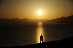 Chinese man at sunrise Royalty Free Stock Image
