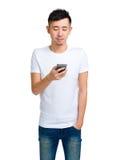 Chinese man using smartphone Royalty Free Stock Photo