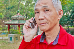 Chinese man answering the phone Royalty Free Stock Images