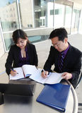 Chinese Man and Woman on Computer stock photo