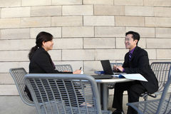 Chinese Man and Woman at work Royalty Free Stock Photography