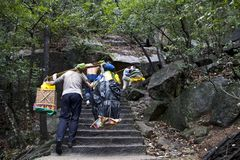 Chinese Man Worker , Carry all stuff to the mountain. Huangshan royalty free stock photos