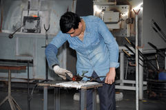 Chinese Man working with Hot Glass Royalty Free Stock Photo