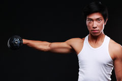 Chinese man working out with dumbbell Royalty Free Stock Photos