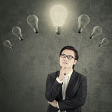 Chinese manager under lightbulb Stock Photos