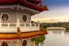 Chinese marble bridge temples reflecting in the lake in the Chin. Ese garden in Singapore Royalty Free Stock Photo