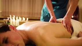 Chinese massage therapist doing massage