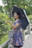 Chinese mature woman in park Stock Photo