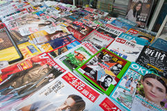 Chinese mazgines. Beijing, China - April 1st, 2013: a lot of Chinese magazines on a newsstand in Beijing stock images