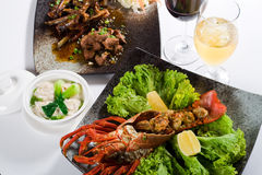 Chinese meal. With lobster, beef and dumpling soup royalty free stock photography