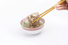 Chinese meat soup with chopstick Stock Photo