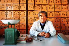 Chinese medicine. An old doctor of traditional Chinese medicine stock images