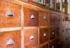 Chinese medicine cabinet wooden. Chinese medicine cabinet wooden in the old herbal medical shop stock images