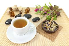 Chinese Medicine. A cup of herbal tea and Chinese medicinal herbs Royalty Free Stock Photos