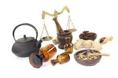 Chinese medicine with herbs and scale Royalty Free Stock Photo