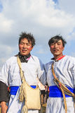 Chinese men in ancient Bai Yi clothing during the Heqing Qifeng Pear Flower festival Royalty Free Stock Image