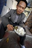 Chinese men eat on street Stock Photography