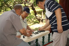 Chinese men play domino Stock Images