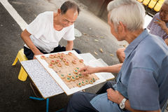 Chinese men playing chess outdoor Royalty Free Stock Photo