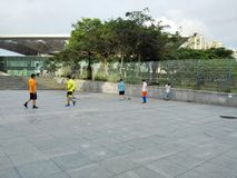 Chinese men are playing football Royalty Free Stock Images