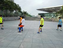 Chinese men are playing football Stock Image