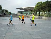 Chinese men are playing football Royalty Free Stock Photo
