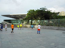 Chinese men are playing football. In the afternoon, several men are playing football as a leisure time. In Shenzhen, china Royalty Free Stock Image