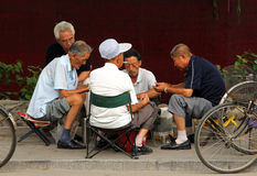 Chinese men playing mahjong or majiang, very popular chinese game in Jingshan park, not far from Forbidden City Stock Image