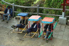Chinese men resting in their chairs Royalty Free Stock Photos