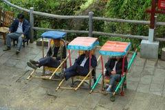 Chinese mensen die als hun voorzitter rusten Royalty-vrije Stock Foto's
