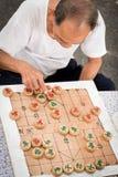 Chinese mensen die schaak spelen openlucht Stock Foto