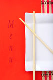 Chinese menu. Chinese sticks on plate with color paper suitable for text Stock Photo