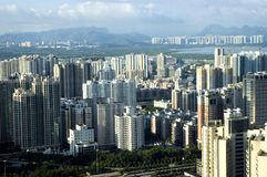 Chinese metropolis. Modern Shenzhen city with office's skyscrapers, hotels and residential buildings Stock Photos