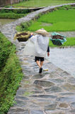 Chinese Miao nationality farmer in the rain Stock Photo