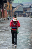 Chinese Miao nationality woman back the child Royalty Free Stock Photos